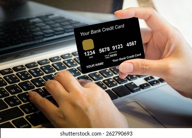 Hand Holding Credit Card Over Laptop Online Shopping Concept