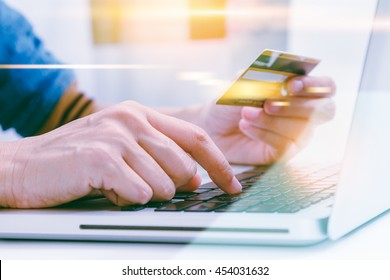 Hand holding credit card with hand for payment online shopping, this lifestyle new generation of people on the world for decorate or design business content or finance concept.