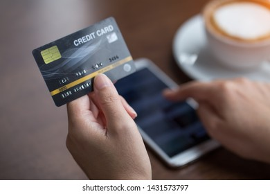 Hand holding credit card with shopping online. Online payment concept.