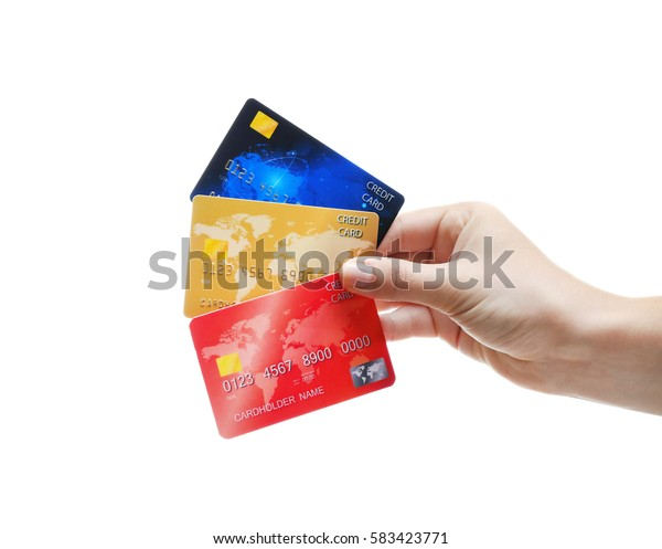 Hand holding credit cards isolated on white