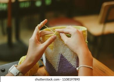 hand holding crochet make handmade bag