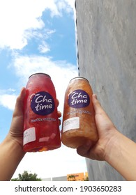 Hand Holding Cups of Refreshing Drink from Chatime, Indonesia (20-12-2020)