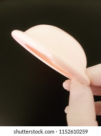 Hand holding a diaphragm contraceptive method