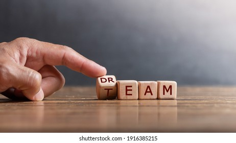 "hand holding dice with text for illustration of ""Dream team"" words"