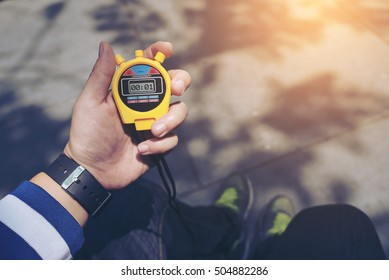Hand Holding Digital Chronometer for Counting a Time