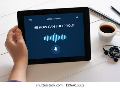 Hand holding digital tablet computer with voice assistant concept on screen. All screen content is designed by me