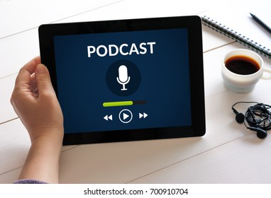 Hand holding digital tablet computer with podcast concept on screen. All screen content is designed by me