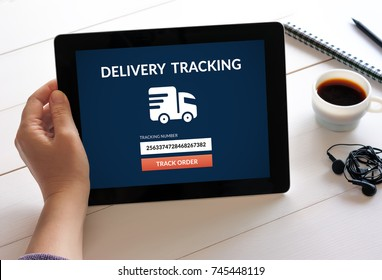 Hand holding digital tablet computer with delivery tracking concept on screen. All screen content is designed by me