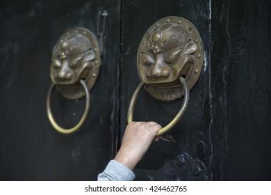 hand holding a door handle