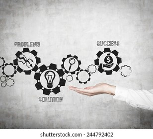 hand holding drawing gears with business icons