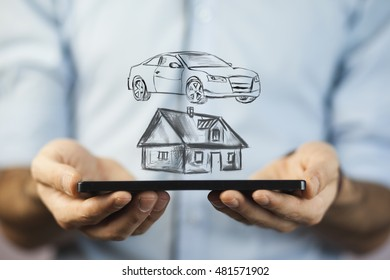 hand holding hand drawn house and car