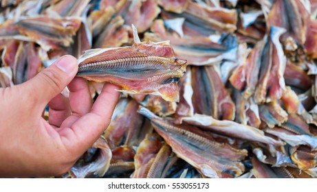 Hand holding dry fish at the market, Dried fish background