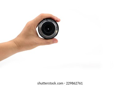 Hand holding DSLR lens from the left isolated on white