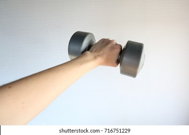 hand holding dumbbell on a white background