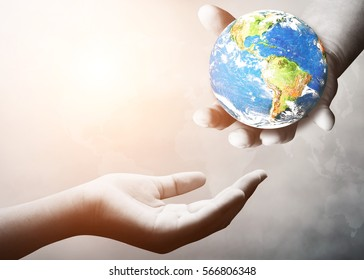 Hand holding earth for the opportunity and support. helping misery,wanting to help. The concept of aid. Elements of this image furnished by NASA