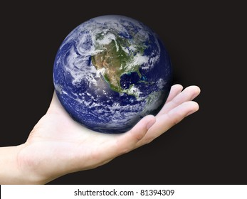 Hand holding earth (Earth view image from http://visibleearth.nasa.gov)