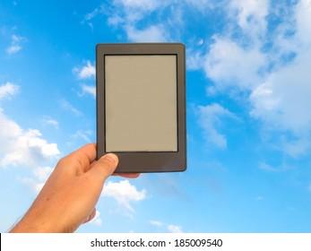 Hand holding an e-book reader