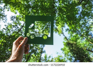 Hand holding eco friendly green living symbol