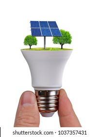 Hand holding eco LED light bulb with solar panel isolated on white background. Concept of green energy.