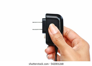 Hand holding Electric plug on white background