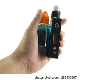 Hand holding electronic cigarette and e-juice isolate on white