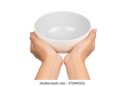 Hand holding an empty bowl isolated on white background