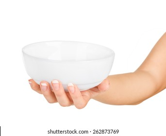 Hand holding an empty bowl on a white background
