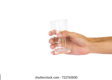 Hand holding empty glass isolated on white background with clipping path.