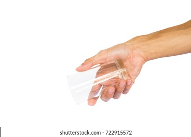 Hand holding empty glass like a pouring water isolated on white background with clipping path.