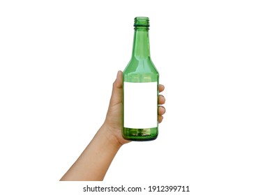 Hand holding an empty green glass bottle with a text space isolated on a white background with the clipping path.