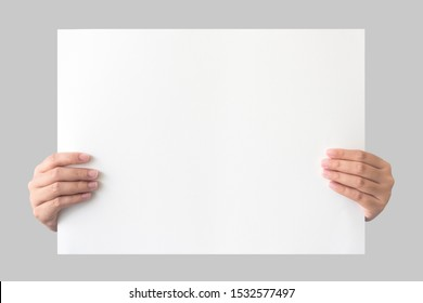 hand holding empty placard paper isolated on grey background with clipping path