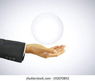 Hand holding empty transparent bubble - can be used as copy space for text or objects