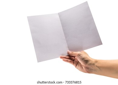 Hand holding empty white paper brochure mock up for advertising. With clipping paths