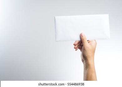 hand holding envelope on white background