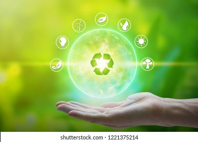Hand holding with environment Icons over the Network connection on nature background, Technology ecology concept.