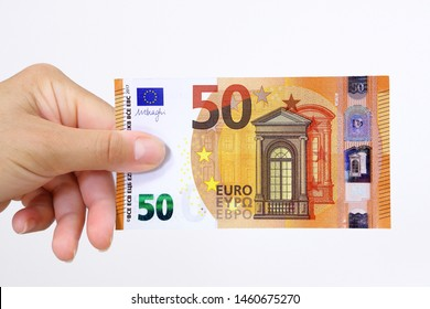 Hand holding a euro bank note