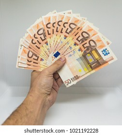 hand holding fifty euro notes