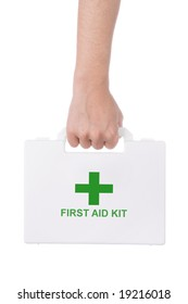 Hand holding a first aid kit isolated on white background