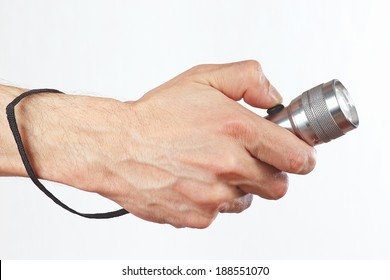 Hand holding a flashlight on a white background