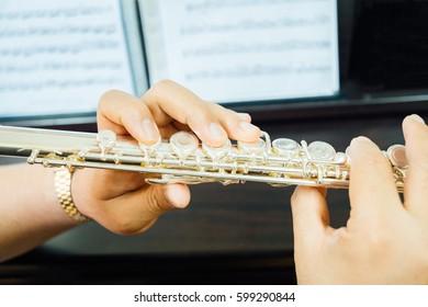Hand holding flute