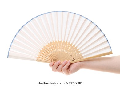 Hand holding folding fan isolated on a white background