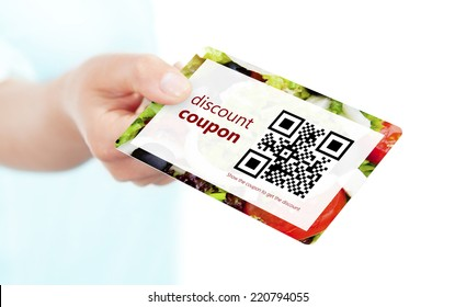 hand holding food discount coupon with qr code isolated over white background