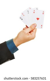 Hand holding four different aces while playing poker