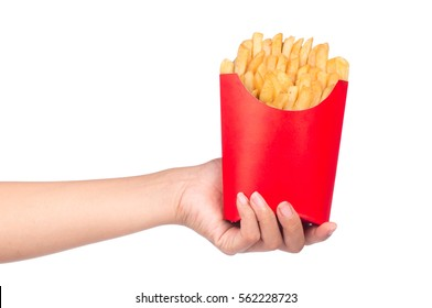 hand holding French fries in a red paper bag isolated on a white background
