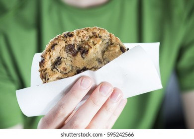 Hand Holding a fresh Hot Baked Chocolate Chip Cookie for Dessert