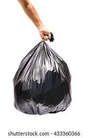 Hand holding garbage bag isolated on white background.