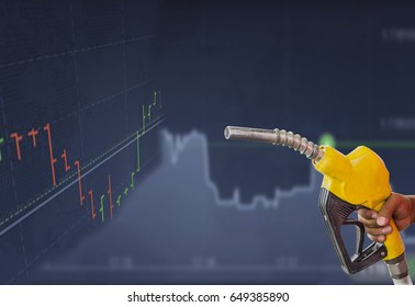 hand holding gas pump with uptrend line graph, bar chart background.