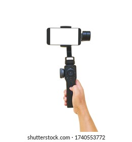 Hand holding gimbal with smartphones isolated on white background