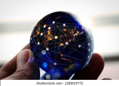 Hand holding Global world telecommunication network connected around planet Earth for internet and worldwide communication finance with blockchain and IoT,Elements of this image furnished by NASA