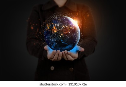 Hand holding Global world telecommunication network connected around planet Earth for internet and worldwide communication technology with blockchain and IoT,Elements of this image furnished by NASA